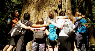 Lewis & Clark students hug a tree at Opal Creek--isn't this what spring break is all about?
